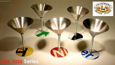 """Traffic Sign Martini Glasses -The eco-friendly way to have a cocktail! These rugged goblets are made with a recycled traffic sign base, nuts & a bolt for the stem, and a non-recycled, food-grade stainless steel cup. Perfect for frozen drinks, shrimp cocktails, and for desserts like ice cream. 7"""" Tall x 4 3/4"""" Diameter and holds approximately 7.5 oz  Price: $49.00 each USD (Includes shipping to continental US) Traffic sign colors vary – See InStock section for availability at TrippworX.com ."""