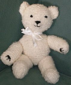 Hand Knitted in 100% wool, traditional teddy bear with hand embroidered features, he is made to order and completely unique.