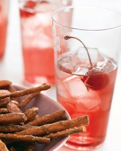 Pomegranate Soda-      * 1 cup sugar      * 1/2 cup pomegranate juice      * Club soda, for serving      * Maraschino cherries, for garnish (optional)