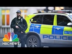 LONDON — A man armed with a knife and wearing a fake explosive device strapped to his body was shot and killed by the police in South London on Sunday after he was suspected of stabbing people on Sunday.