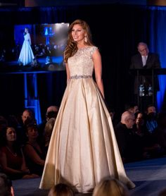 Wearing this youthful ivory evening gown, Katy Brown caught the judges' eyes and captured the title of Miss Connecticut Teen USA 2016! She will be representing her home state at this year's Miss Teen USA pageant.  The Color -  Ivory is becoming more popular this year as more and more contestants are seeking evening gowns in shades of white.  This color works with Katy's brown hair; however, I do not think that it complements her complexion. I would like to see Katy wear this gown in a stark…