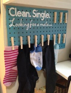 DIY Lost Socks holder for laundry room. Spray painted scrap pegboard, cut Cricut vinyl, glued on clothespins...easy and cute idea! (Laundry room organization)