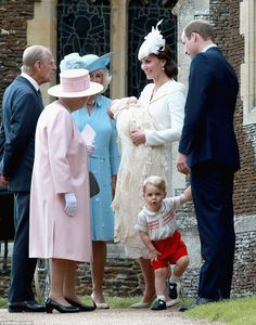 Cheeky George pulled this funny face at the waiting photographers and balanced on one leg while his parents chatted to the Queen, Prince Philip and Camilla