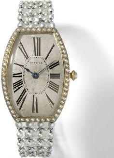 Tonneau Wristwatch, Cartier Paris, 1907 - Photo N. Welsh -Pierre Rainero, guardian angel of the Cartier style - Fondation de la Haute Horlogerie