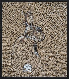 "Sandra Groeneveld mosaic. ""Konijntje"" (aka Bunny) Stone on cement board 15.25\' x 17.5\"" I enjoy this craft because it definitely took some time to make and it must have been very difficult to find the exact pieces to fit the picture."