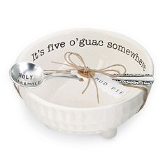 """2-piece set. Ceramic dimple textured dip cup features resist """"It's five o'guac somewhere"""" sentiment on interior rim and arrives with """"HOLY GUACAMOLE"""" stamped silverplate spoon. We love giving this as a wedding, housewarming or hostess gift for friends to use in their kitchen. And a perfect addition to Mexican night on Taco Tuesday!"""