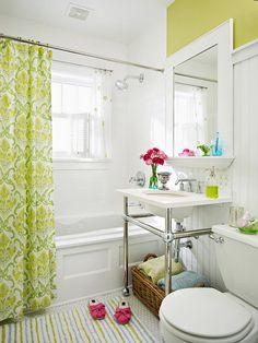 Small Bathroom Area with Bathtub and Green Curtains