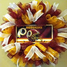 Are you a die-hard Redskins fan or know someone who is? Get your game on with this fantastic Redskins football wreath. This is the perfect gift