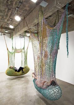 Brazilian artist Ernesto Neto creates massive crochet installations reminiscent of the playgrounds by Horiuchi MacAdam, but in more muted tones. Strung from gallery ceilings, these strange little 'nests' offer an inhabitable space that can be either playful or quiet and comforting. Larger pieces encourage running and jumping, while the smaller ones are cocoon-like relaxation spaces.