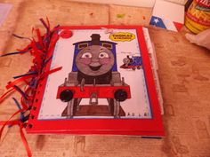 Scrap Happens With Rhonda:thomas the train mini album~ http://scraphappenswithrhonda.blogspot.com/