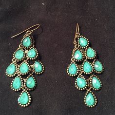 Turquoise chandelier earrings Gold backing. Turquoise chandelier earrings. Come with a clear stopper. Urban Outfitters Jewelry Earrings