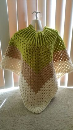 Hot Off My Hook! Project: Cowl-Neck Poncho Started: 28 July 2015  Completed: 31 July 2015 Model: Madge the Mannequin Crochet Hook(s): 7.00mm Yarn: Redheart Super Saver  Bernat Super Value Color(s): Grass, Buff, & Natural Pattern Source: Simply Crochet Magazine Issue No. 25 Pattern Design: Simone Francis Notes: This is my 13th cowl neck poncho! I used a 7mm hook for the entire piece. This was a last  shower gift for  special friend. Binge watching Sons of Anarchy helped me get er done!