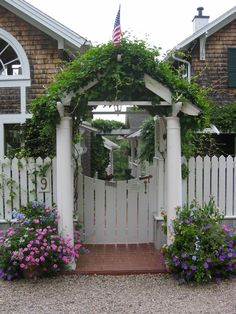 Rhode Island cottage. This gate with vine covered arbor is sweet!! Goff Architecture.
