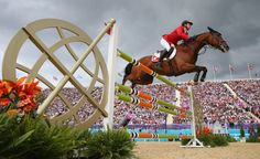 LONDON, ENGLAND - AUGUST 08:  Steve Guerdat of Switzerland wins Gold riding Nino Des Buissonnets in the Individual Jumping on Day 12 of the London 2012 Olympic Games at Greenwich Park on August 8, 2012 in London, England.  (Photo by Alex Livesey/Getty Images)