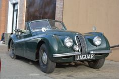 This 1953 Jaguar XK120 Drophead coupe is a green with green interior, matching numbers, excellent honest car to restore. Only for $56,500.  #gullwingmotorcars #classiccars #buy&sellclassiccars #VintageCarBuyer #ClassicCar  #antiqueCarBuyer #1953JaguarXK120Dropheadcoupe #JaguarXK120Dropheadcoupe #rXK120 #Jaguar
