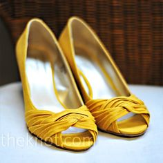 """Even though Tara knew she wanted yellow shoes, she had difficulty finding the perfect pair (she's almost 5'9"""" and didn't want too high of a heel). She finally found it the week before the wedding."""