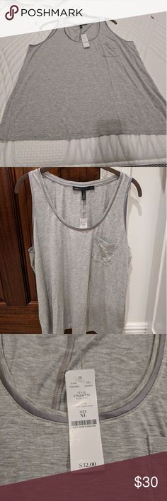 🐨 WHBMTank Top Never worn!! I have a black and a navy blue with white stripes as well. They are NWOT. White House Black Market Tops Tank Tops