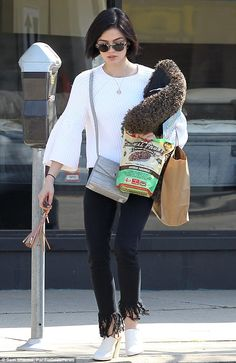 Puppy love! Pretty Little Liars Lucy Hale wore frayed edge jeans as she picked up some tre...