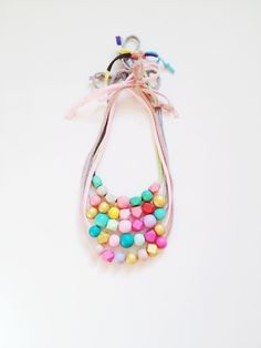 Coral + Cloud creates modern, hand-made, hand-painted wooden bead necklaces and mobiles that are versatile and fun, and that add a pop of colour to any outfit or room.