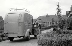 1950. Fight against the malaria mosquito in Amsterdam. When the G.G.D car stops to spray a house, women from the neighborhood ask if their houses can also be sprayed. Photo Archive Spaarnestad Collection. #amsterdam #1950