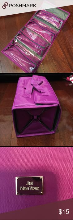 Magenta makeup bag This bag has 4 zipper bags that can be easily taken out shown in the fourth photo. This bag is very compact and perfect to organize your makeup on the go. In great condition Makeup