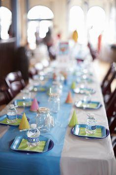 octonauts themed birthday party tablescape plates birthday hats peso bandaids mini water bottles