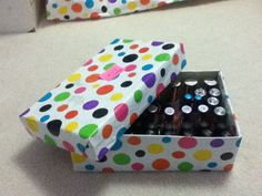 Nail polish organizer DIY: Reuse old shoe box with just glue and wrapping paper (or newspaper your choice) Super easy!