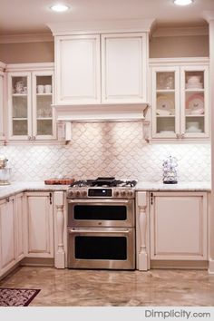 You don 39 t see a scallop white mosaic tile backsplash that for Dove white cabinets with cocoa glaze