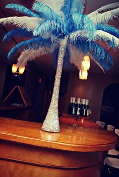 Feather Centerpiece (photo by Y. Abreu Photography) ...this is kinda awesome...