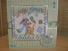 """This fun card measures 8"""" x 8"""" in size and comes with a white envelope and protected in a cello bag. The topper features a man and his dog, has silver foiled accents around the edge and has been raised to give dimension. The sentiment reads """"Just For You"""". Card Candi, a silver bow have been used to decorate. The inside has been left blank for your own personal message.   http://www.makesellbuy.com/products/view/136299176088/handmade-birthday-card-man-and-his-dog"""