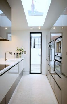 The design in this picture is not supposed to be relevant for the kitchen but rather its exposure to light and special quality. The kitchen has a large window along its west face and a single spotlight that is suppose to resemble the rest of the ceiling throughout the house.