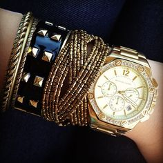 Michael Kors Watch  I love the Rose Gold/Gold watch look stacked with different chunkier bracelets.