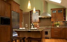 Love the contemporary design style, but hate the cool, sterile look of white cabinets? Here's how to design your own warm contemporary kitchen! Contemporary Style Kitchen, Contemporary Kitchen Remodel, Contemporary Kitchen, Bath Design, Kitchen Design, Kitchen And Bath Design, Kitchen, Cheap Kitchen Cabinets, Kitchen Styling