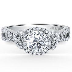 """Kirk Kara 18K White Gold Halo """"Mini-Pirouetta"""" Engagement Ring Featuring Bow Tie Designs on Each Side of Engagement Ring.Center. Style K174C65R"""