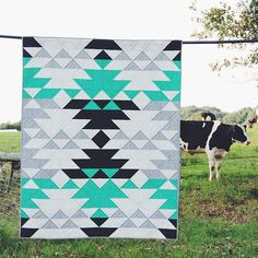 """A quilt and a cow! I took my outside, and the cows were actually a bit curious. ☺Pattern found in Colour Ideas for equilateral triangle quilt. Quilting Projects, Quilting Designs, Sewing Projects, Southwestern Quilts, American Quilt, Quilt Modernen, Barn Quilts, Quilt Making, Quilt Blocks"