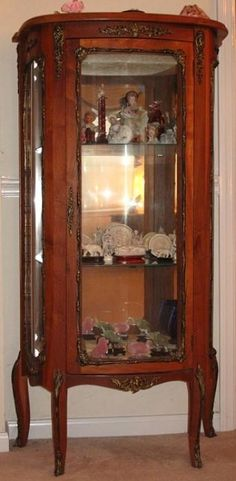 """French Antique Vitrine (54""""H x 28""""W x 13""""D) w/ Bronze Ormolu. Interior is Mirrored Back with 2 Glass Shelves and brocade Fabric lower Shelf Standing on 4 Cabriole Legs"""