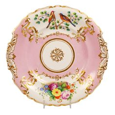 A Russian Imperial Porcelain Factory plate, Nicholas I period (1825-1855). The cavetto of the shaped gilded-rim plate painted with gilt vining cartouches, one filled with a floral bouquet and the other with a pair of brightly colored birds resting on a branch, all against a deep pink ground. Reminds me of my last Dresden plate that I just broke stacking dvds. Grrrrr!