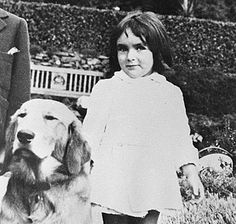 Elizabeth Taylor didn't begin to walk until she was 16 months old. She is shown here with one of the many dogs for which she cared during her lifetime. ca.1934-35