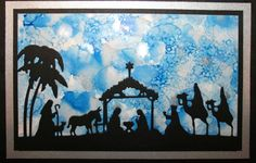 Christmas card on an alcohol ink background with a Taylored Expressions Nativity Border die cut.