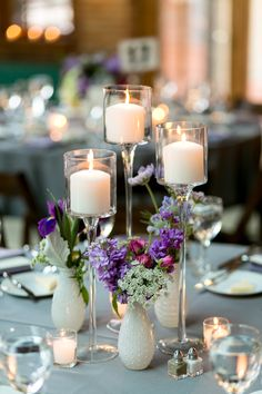 Bud Vase and Tall Candle Centerpiece | photography by http://shanewelch.com | floral design by http://www.scarletpetal.com/