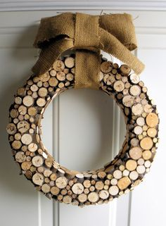 fantastic christmas wreath hand-crafted with wood slices.  choose a burlap bow or something more glitz-y for decoration...from the blog 'dishfunctional designs': jewelry designer laura beth love shares a few ideas on branching out via art & decor from wood slices...so cool!  http://dishfunctionaldesigns.blogspot.com/2012/02/branching-out-art-decor-from-branches.html