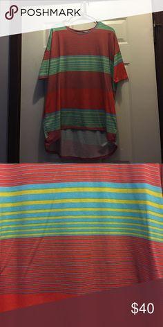 "Lularoe Irma Lularoe Irma size Medium. Fits size 12-14. Striped bright colors. Orange green blue yellow. This Irma is the ""buttery soft"" leggings material! LuLaRoe Tops"