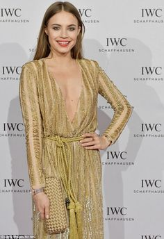 Golden girl: Uma rubbed shoulders with a host of guests including Xenia Xenia Tchoumitchev...