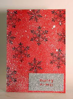 Christmas card with HEMA merry x-mas punch, brushed pewter distress spray stain and the snowflakes are from Hero arts get merry stamp set with black staz on ink