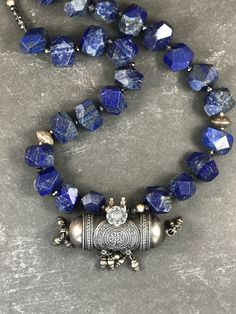 Neelambari - beautiful blue lapis lazuli beads with a strikingly stunning sterling silver amulet from India. Handmade by Jayanthi Kanderi for Mahasara Studio!