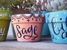 Makewells for alisaburke: lettering on terracotta pots
