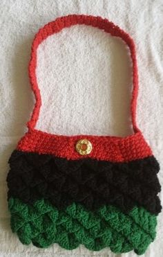 Red, Black and Green purse, created by Stacey R Long.
