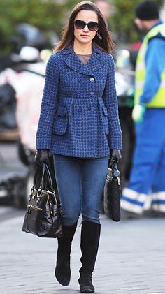 December 9, 2011  Pippa embraced the winter weather by pairing a fitted blue peacoat with her black Russell and Bromley boots, and Goldsign jeans. She carried her signature Modalu bag to finish off the outfit.