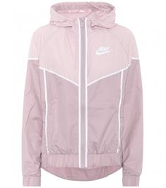 Nike Windrunner jacket is a running layer designed with high performance in  mind and has been part of the label s activewear line since 1978  women ... 0f7bad2aa