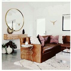 love how worn this leather sofa looks...